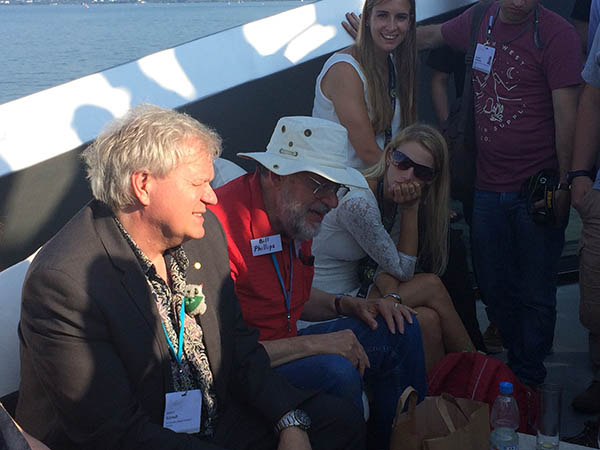 Nobel laureates Brian Schmidt and Bill Phillips enjoy some time out on the water with Lindau meeting attendees. Credit - Alaina Levine