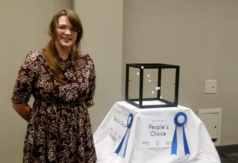 "Caroline Bowen, University of Tennessee, Knoxville, is pictured with her piece ""Asterism,"" which won the ""Best in Show"" and ""People's Choice"" awards."