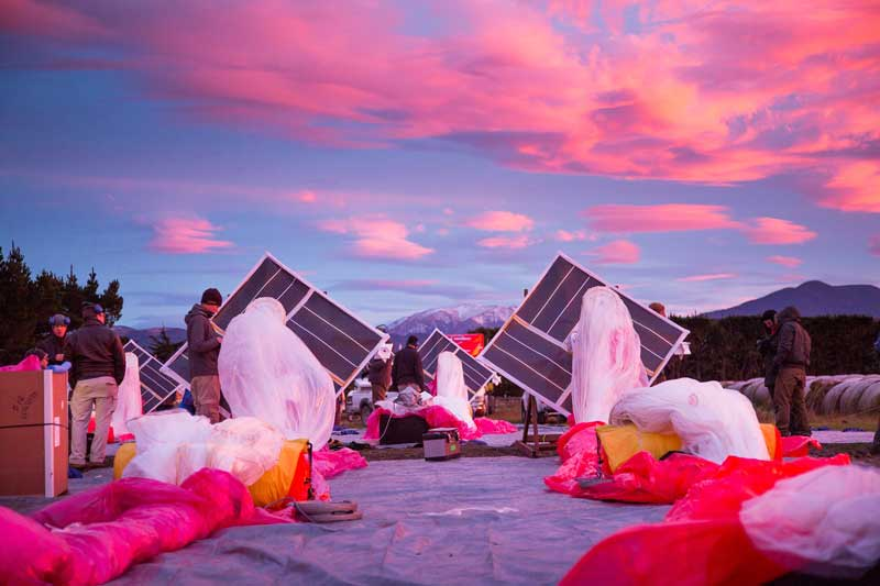 The Project Loon team prepares solar panels, electronics and balloon envelopes for launch as the sun rises in New Zealand. Photo courtesy of Project Loon / X.
