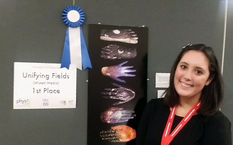 "Jordan Rice, Carthage College, is pictured with her piece ""We are all made of starstuff,"" which won first place in the Unifying Fields (Mixed Media) category."