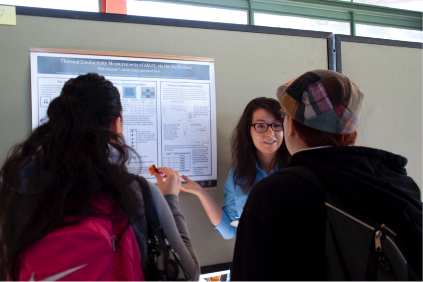 A conference attendee shares her research at the poster session.