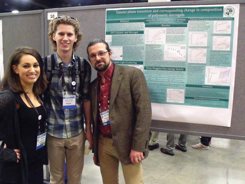 The author poses with Jana Mino and Kiril Streletzky in front of their poster on microgels (right).