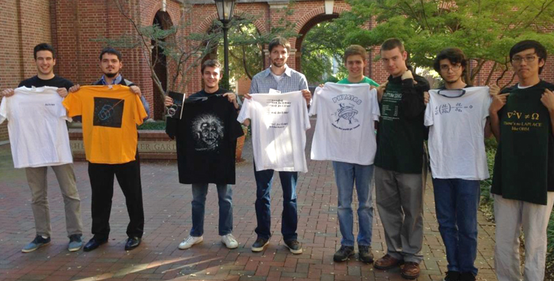 Students stick around to show off their newly won physics shirts.
