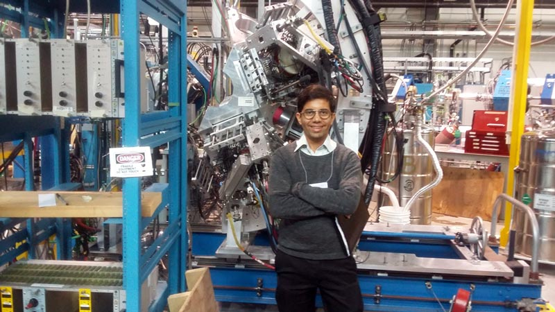 The author is pictured inside TRIUMF, Canadian National Lab.