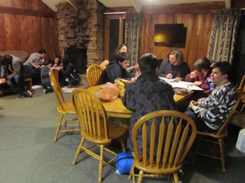 Students work in a cabin to complete the team logic puzzle competition.