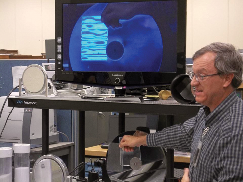 NASA's Bob Youngquist demonstrates a device for  detecting leaks.  Photo by Michael Harrington