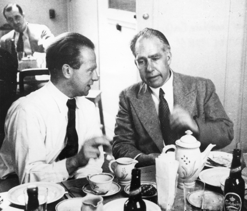 Niels Bohr and Werner Heisenberg converse over drinks at the Bohr Institute Conference in Copenhagen, Denmark. Photograph by Paul Ehrenfest, Jr., courtesy AIP Emilio Segre Visual Archives, Weisskopf Collection