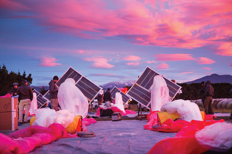 The Project Loon team prepares solar panels, electronics, and balloon envelopes for launch as the sun rises in New Zealand. Photo courtesy of Project Loon / X