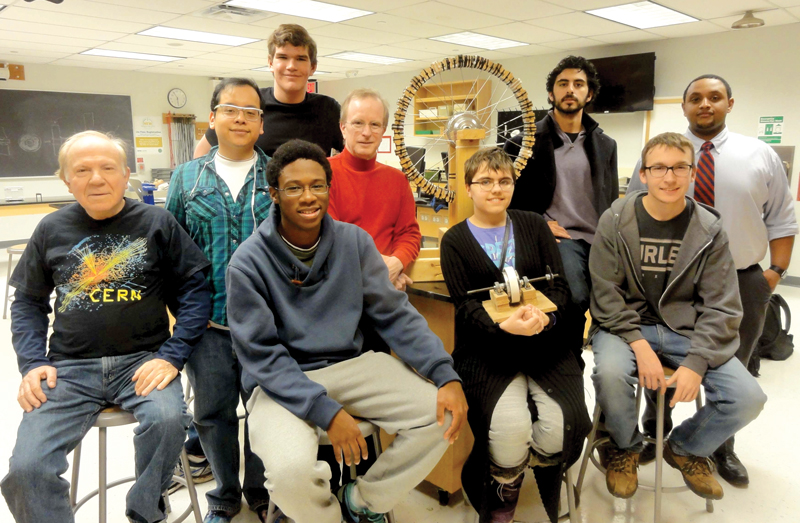 Students from Northern Virginia Community College with their Self-Driven Electromagnetic Wheel.  Photo courtesy of NVCC SPS chapter