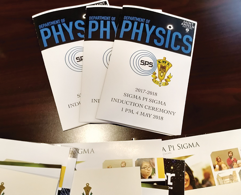 Induction materials from the installation of the Saint Anselm College Sigma Pi Sigma chapter. Photo courtesy of Brad Conrad.
