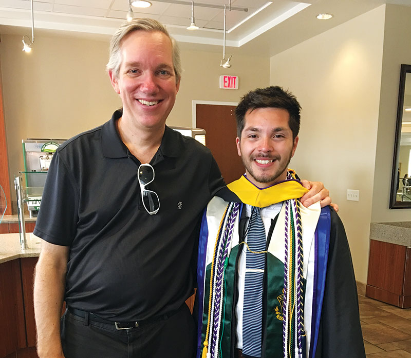 High Point University physics department chair Dr. Aaron Titus sending off last year's SPS president, Alan Vasquez. Photo courtesy of the HPU Department of Physics.
