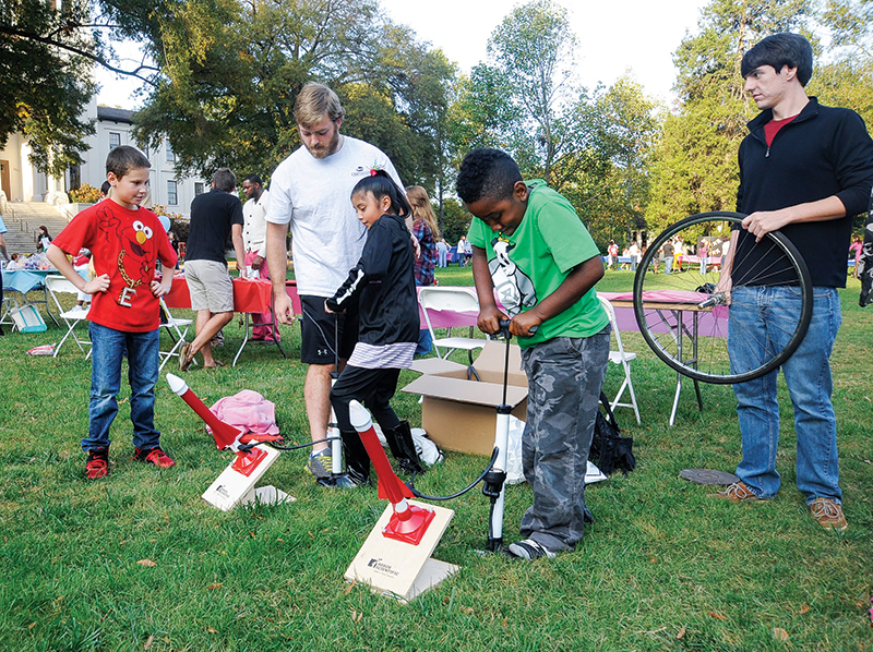 The Wofford College SPS chapter participates in the Terrier Play Day event held each spring. The event brings local elementary school children to campus for a safe and fun place to play. In this photo, two SPS members work with attendees to launch air rockets. Photo by Mark Olencki.