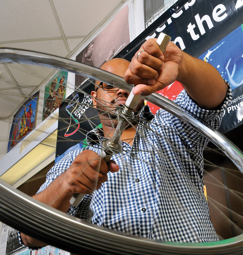 CSU physics alum Sean Gallardo exploring torque and angular momentum as a student. Photo by Brent Jones.