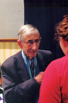 Professor Dyson at the 2012 Sigma Pi Sigma Congress, conversing with a student. Photo courtesy of Dwight  Neuenschwander.