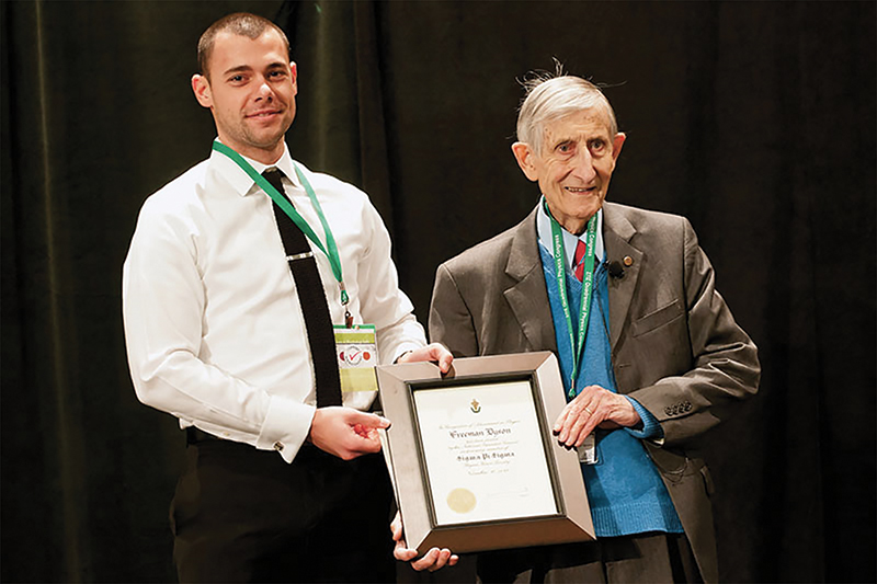 SPS Zone 9 associate zone councilor Brandon Clary (left) inducts Freeman Dyson (right) as an honorary member of Sigma Pi Sigma in 2012. Photo courtesy of SPS National.