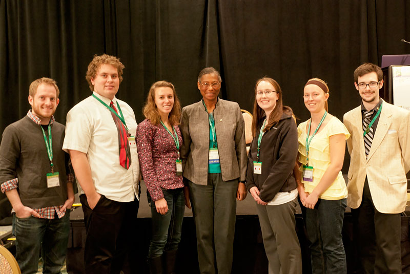 Group photo of several UWRF students with Richards immediately after her presentation.