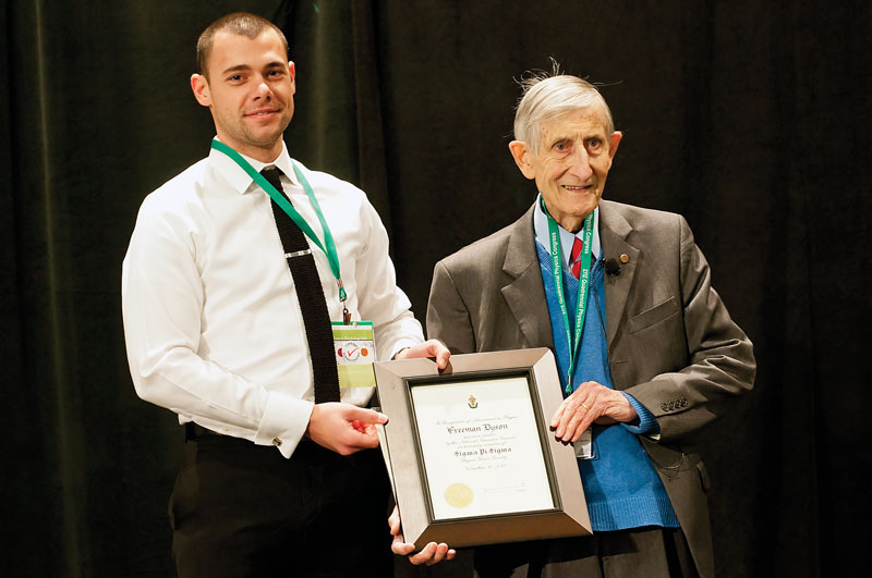 SPS Zone 9 Associate Zone Councilor Brandon Clary (left) inducts Freeman Dyson (right) as an honorary member of Sigma Pi Sigma.