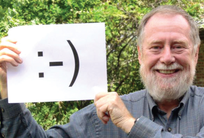 See the resemblance? Scott Fahlman poses with the emoticon he invented. Photo courtesy of Scott Fahlman.