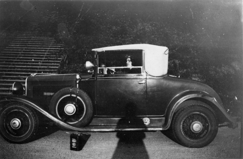 Melba Phillips sits at the wheel of Robert Oppenheimer's car, which appears to be a 1929 Chrysler convertible coupe. The photographer must have been Robert, as he and Melba would go out to dinner together. Photo courtesy of AIP Emilio Segrè Visual Archives.