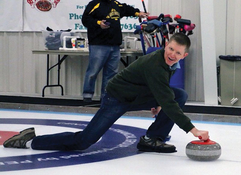 A still shot from a YouTube video shows Destin demonstrating the physics of curling. Photo courtesy of Marquette University SPS chapter.