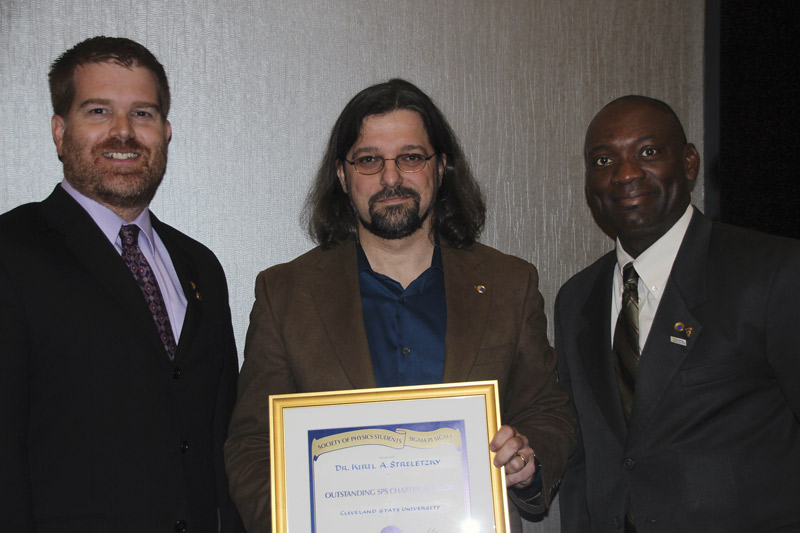 Kiril Streletzky (center) is pictured with Sigma Pi Sigma president Willie Rockward (right) and SPS Director Sean Bentley (left). Photo by Courtney Lemon.