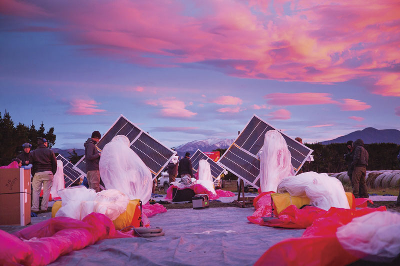 The Project Loon team prepares solar panels, electronics, and balloon envelopes for launch as the sun rises in New Zealand. Photo courtesy of Project Loon / X.