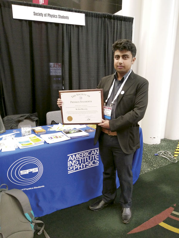 Arpan Sharma poses with the charter for the Vel Tech University SPS chapter, which he received at the APS April Meeting. This is the maiden SPS chapter in India.