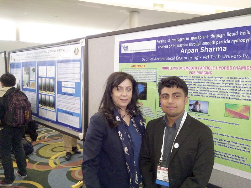 Arpan Sharma is pictured by his poster with Maria Spiropulu, chairman of the APS Forum of International Physics.Photos courtesy of Arpan Sharma.