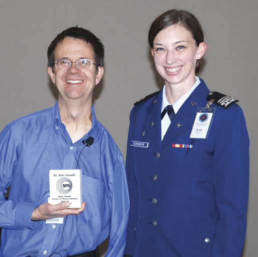 Cadet First Class and SPS President Anita Dunsmore poses with Dr. Cornell after presenting him with an engraved marble plaque, cut from stones that once outlined the cadet marching areas. Photo courtesy of United States Air Force Academy.