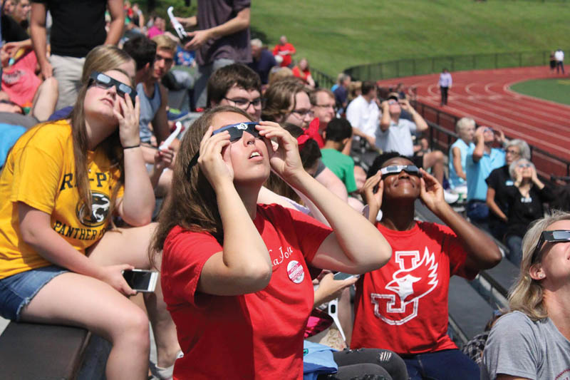 William Jewell College students gaze up at the partial eclipse. Photo by Hannah Wilson.