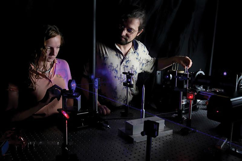 Dr. Kiril Streletzky and SPS Member, Karen Johnson, align a laser beam at Cleveland State University's Light Scattering Spectroscopy Lab. Photo courtesy Dr. Kiril Streletzky.