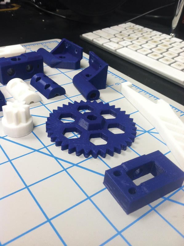 Some of the custom-printed components of the 3D printer.