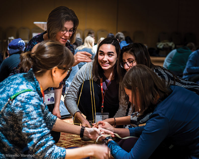 On the first night of the conference, attendees engaged in an icebreaker challenge. Groups of five were tasked with building a pasta tower to support a marshmallow without breaking or falling.