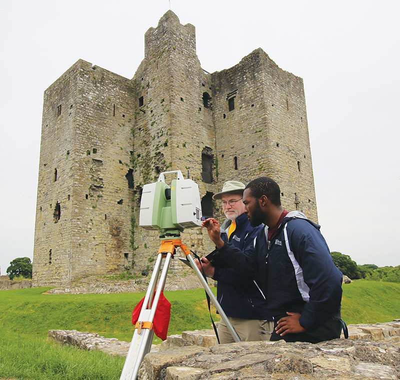Professor Rogers and physics major Chidi Anyata using a Leica C10 3-D laser scanner to digitally preserve the Keep at Trim Castle in Ireland. Trim Castle is the largest Anglo-Norman castle in Ireland, and the Ithaca College team conducted two month-long summer expeditions to take positional readings every 5 mm inside and outside of the Keep, the Barbican Gate, the Curtain Wall, and the surrounding medieval landscape.  Photo courtesy of Professor Rogers.