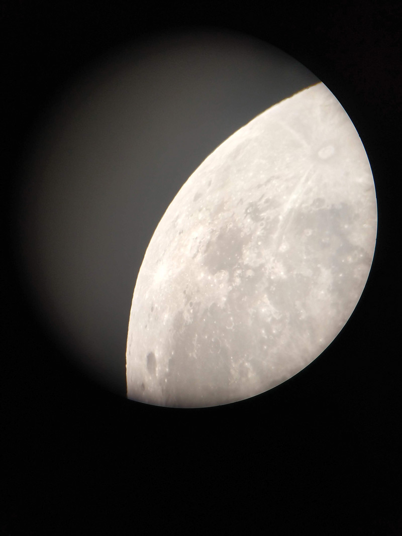 The moon through a telescope at the nighttime observation event. Photo Credit-Dany Waller.