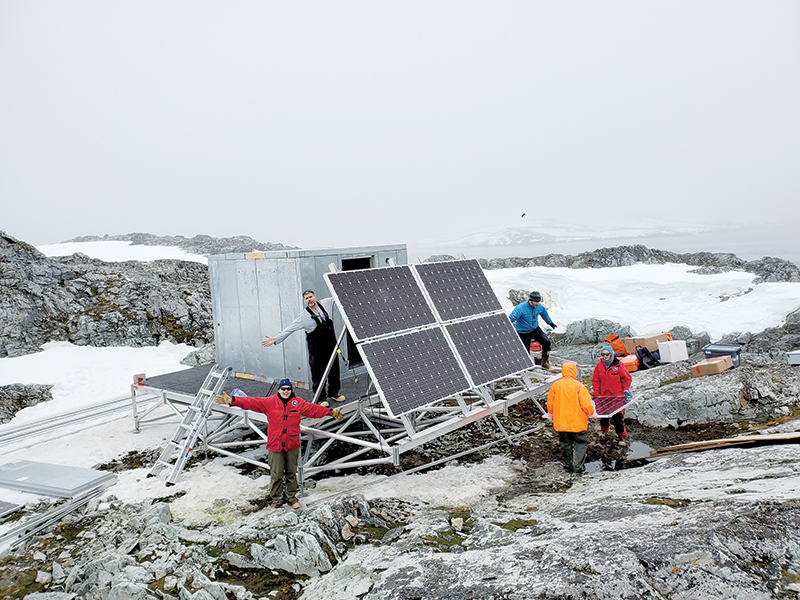 A team installing a high-frequency radar on the Joubin Islands. There are three of these radars installed in a triangle over Palmer Deep. They use backscattering radio waves to map surface currents.