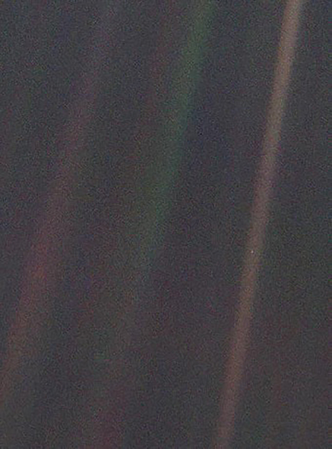 This image of Earth is one of 60 frames taken by the Voyager 1 spacecraft on February 14, 1990, from a distance of more than 6 billion kilometers (4 billion miles) and about 32 degrees above the ecliptic plane. In the image the Earth is a mere point of light, a crescent only 0.12 pixel in size. Our planet was caught in the center of one of the scattered light rays resulting from taking the image so close to the Sun. This image is part of Voyager 1's final photographic assignment, which captured family portraits of the Sun and planets. Photos courtesy of NASA.