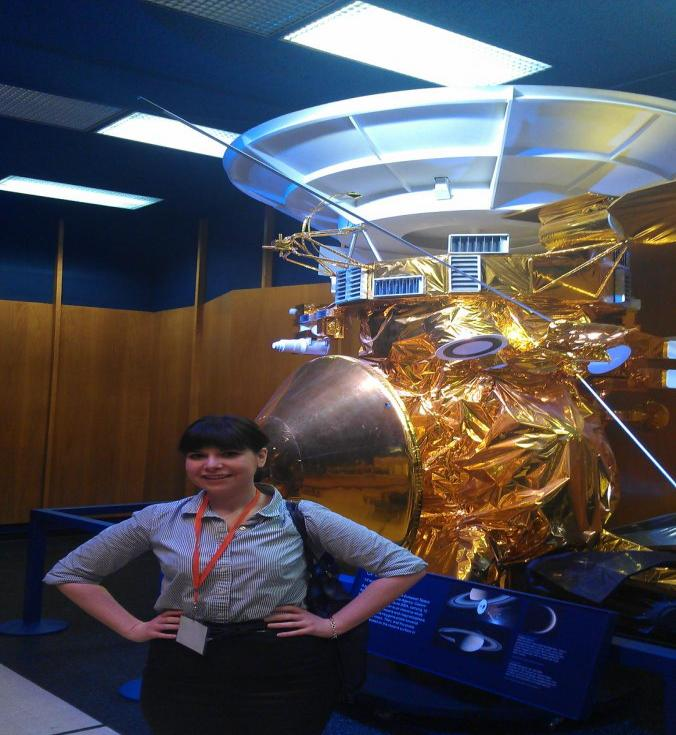 SPS Reporter Angelica Gheen with a model of the Cassini at JPL. Photo courtesy of Angelica Gheen
