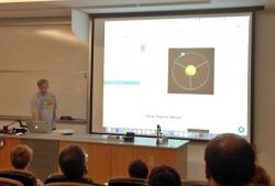 Dr. Aaron Titus teaches students and AAPT members about the orbit of Mars via computer simulation.
