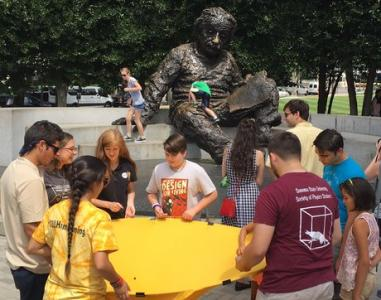 The first shift of SPS interns doing an outreach activity at the Einstein Memorial
