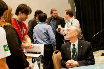 Dr. Mather answers questions from students following his plenary talk. Photo by Ken Cole.
