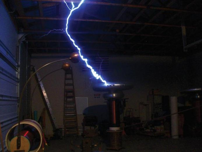 A Tesla coil in action generates a streak of man-made lightning. Photo by Andrew Carly.
