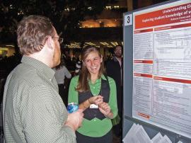 Rebecca Crema describes her research at the 2008 PhysCon at Fermilab. Photo by author.