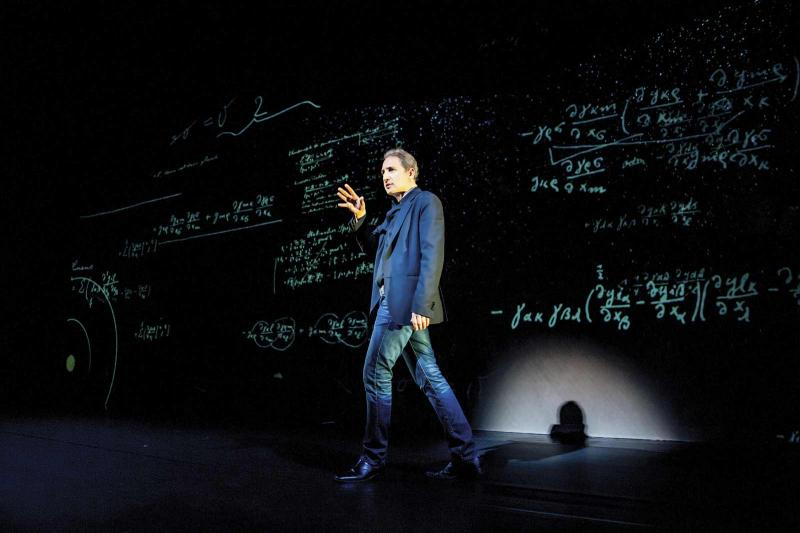 "Brian Greene onstage in ""Light Falls—Space, Time, and an Obsession of Einstein."" Photo courtesy of the World Science Festival."
