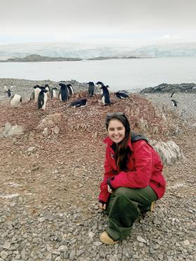 The author in front of a nest of Adélie penguins on Torgersen Island.
