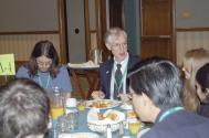 Plenary Speaker and Physics Nobel Laureate John Mather (center) visits with students over breakfast at PhysCon 2012.