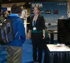 SPS Reporter Jill Pestana discusses the SOFIA Program with an astronomy student at the SOFIA display.