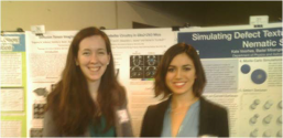 Euginia Volkova and Katie Voorhes show off their research posters.