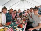 Ian (far left) and Andrew (far right) enjoy a lobster dinner at the conference.