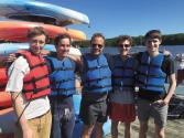 Ian (far left) and Andrew (far right) prepare for a kayaking trip with fellow Tufts researchers.